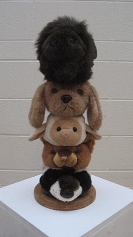 Totem pole of stuffed animal heads