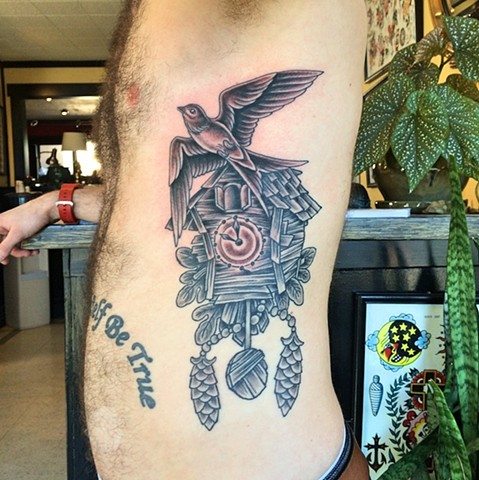 Antique wooden cuckoo clock and sparrow tattoo by Dirk Spece at Gold Standard Tattoo in Bend, OR.