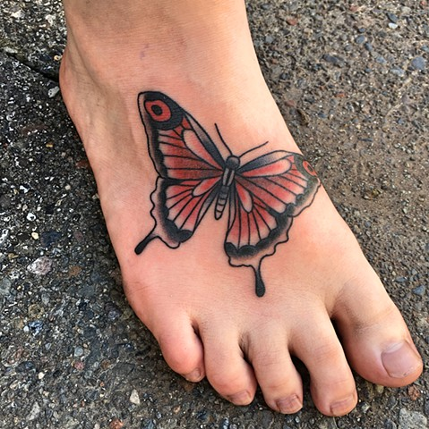 Butterfly foot tattoo by Kc Carew at Gold Standard Tattoo in Bend, OR.