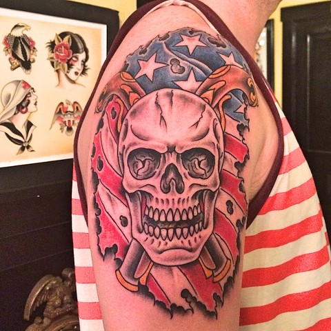 Skull and American flag tattoo by Dirk Spece at Gold Standard Tattoo in Bend, OR.