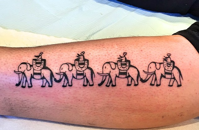 Elephants tattoo by Kc Carew at Gold Standard Tattoo in Bend, OR.