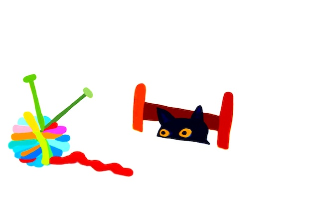 A black cat is just sure the yarn ball is an alien and the two knitting needles are antennae, and he must save the family from attack.