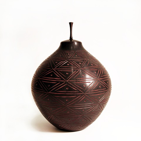 Ebonized and Carved Mahogany Vessel