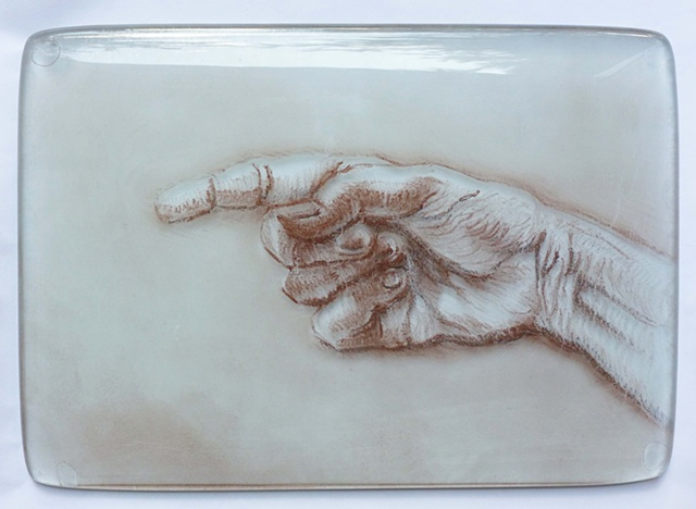 hand pointing in glass with ceramic pencils