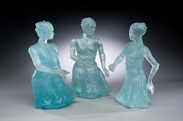 female figures caught in motion, cast in glass using lost wax casting