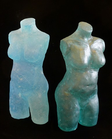 Duality expressed in dual glass sculptures of female torsos