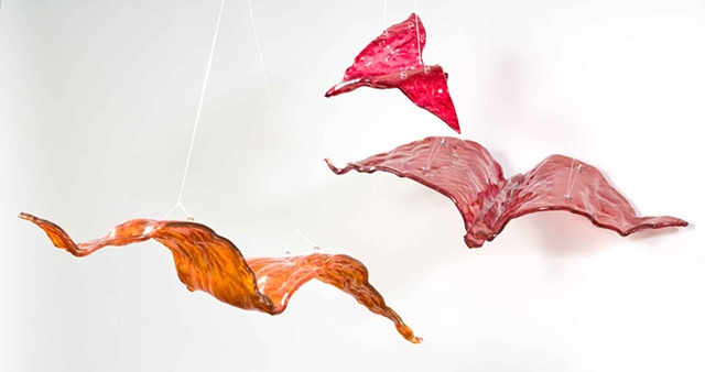 Kiln-formed birds can be suspended from a ceiling or against a wall
