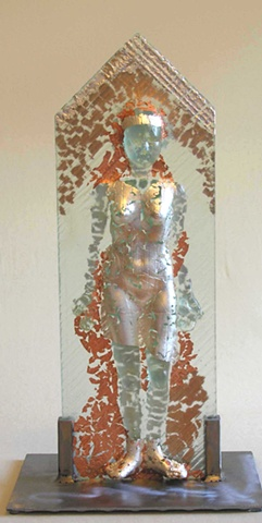 kiln-cast glass female figure supported by steel frame, with silver and copper