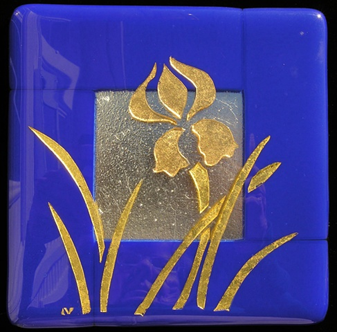 fused glass with silver and gold bits sandwiched inside