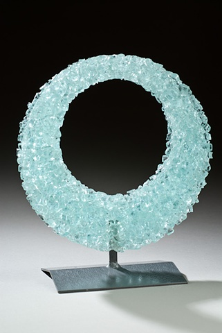 recycled glass re-melted into a new shape, with a welded steel stand