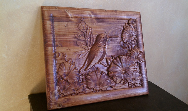 Humming Bird in a Garden of Morning Glories carved into wood for wall display