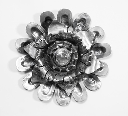 Steel sculpture with Baroque flourishes and hub cap
