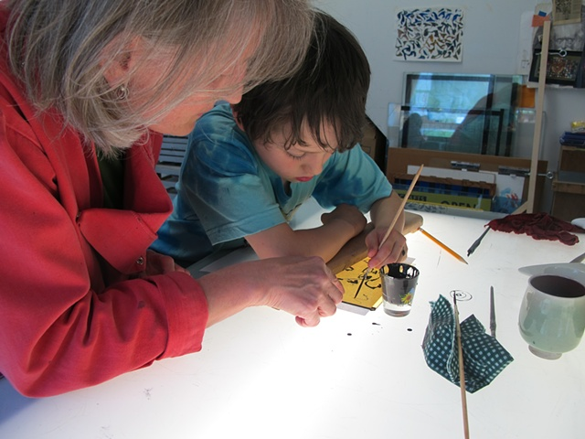 child painting stained glass