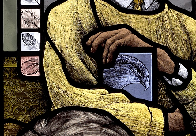 Portrait of British painter Sir William Coldstream with feathers and falcon in knitted sweater; hand painted stained glass by Debora Coombs.