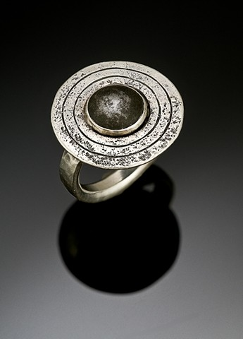 Ring with found piece