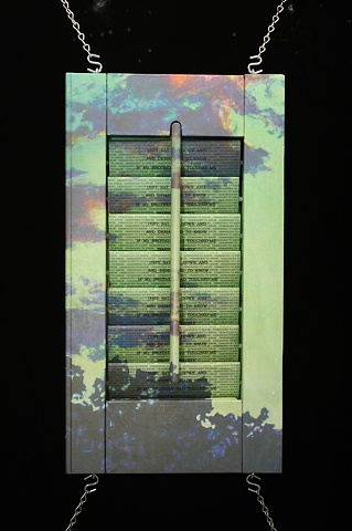 Mixed media--digital landscape image on interior wooden window shutter; one-way mirror and text behind slats.