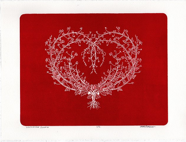 a heart made of branches on a red background