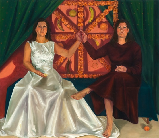 two young women one dressed in a white wedding dress other in red sit on a bench with cupped hands touching