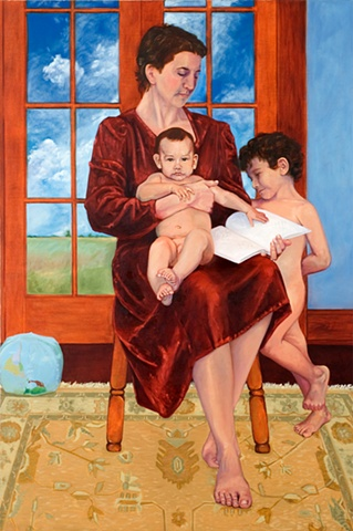 Seated woman with baby on lap holding a book while young boy stands to right