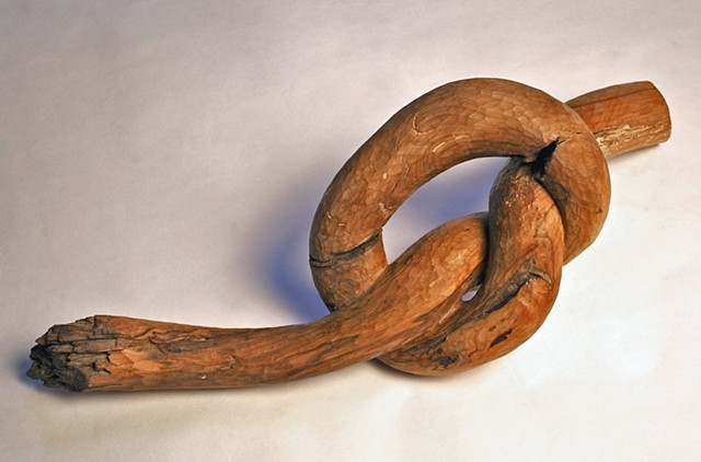 Carved applewood knot form by Lin Lisberger