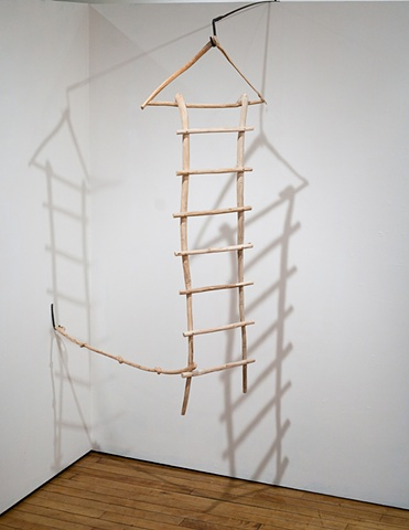 Wood sculpture of ladder with carved knotted rope by Lin Lisberger