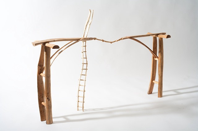 Wood sculpture of bridge, carved knots and ladder by Lin Lisberger