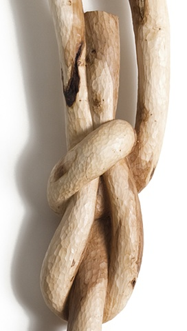 Carved wood sculpture of a knot by Lin Lisberger