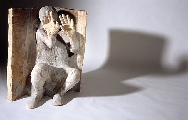 Wood sculpture about torture at Abu Ghraib by Lin Lisberger