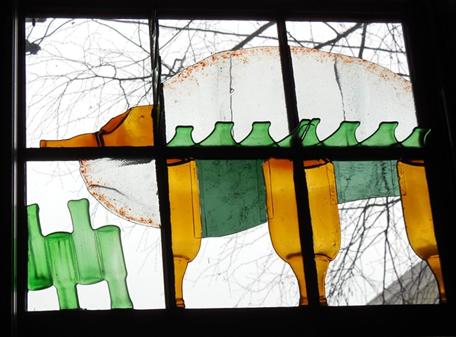 bottle glass, frit in old sash