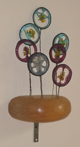 recycled construction lumber, wire, colored glass scraps.