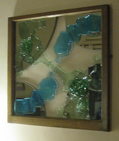 mirrors, bottle glass in old sash