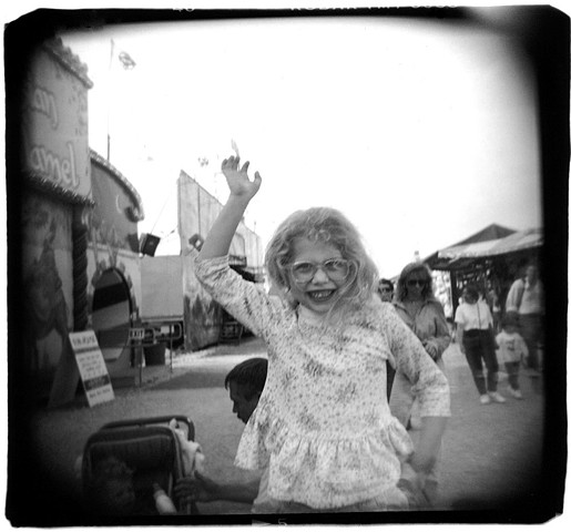 Holga photograph of a young girl at a carnival