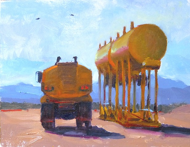 Ass end of a yellow truck, with water tanks