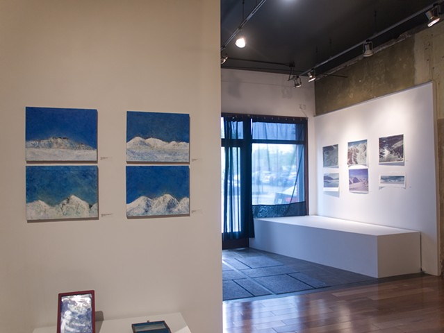 View towards front of gallery - prints on entry and small oils