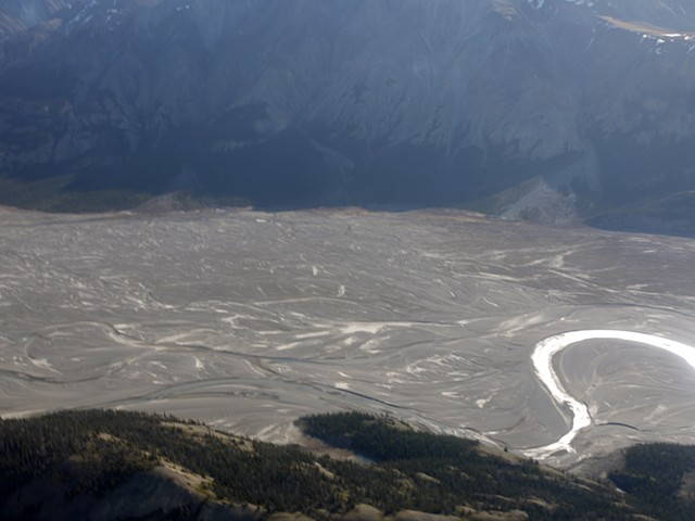 The Kaskawulsh Glacier previously fed the Slims River. In 2016 it retreated so far that it changed course and the river channel is largely empty.