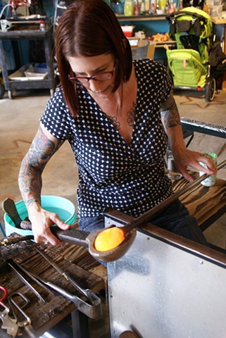 Melissa shaping the glass