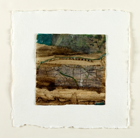 mixed media, found objects, map, thread, mud