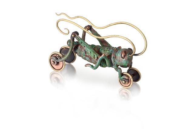 cast bronze grasshopper sculpture on hand-sewn glazed cloth cushion