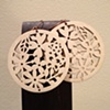 white wooden flower circles