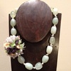 prehnite, pearls, silver jinglies, and silk flower