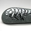 a rock-shaped grub on a grub-shaped rock