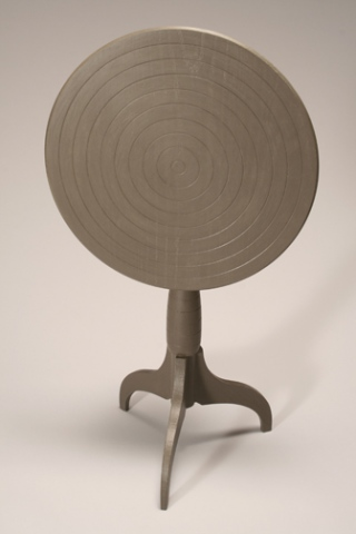 FLAT BROWN PEDESTAL TABLE (detail)