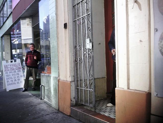 Men Smoking in Doorways