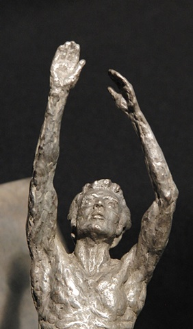 male moving figure sculpture