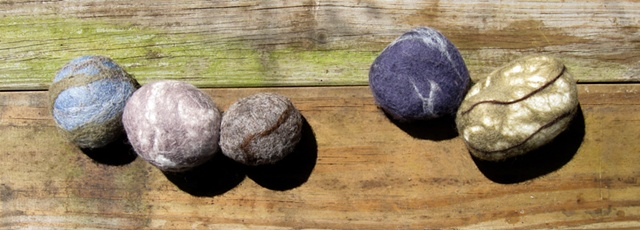real stones covered in felted wool
