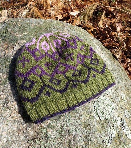 Handknit fair isle hat in purples and greens by chelsea clarke