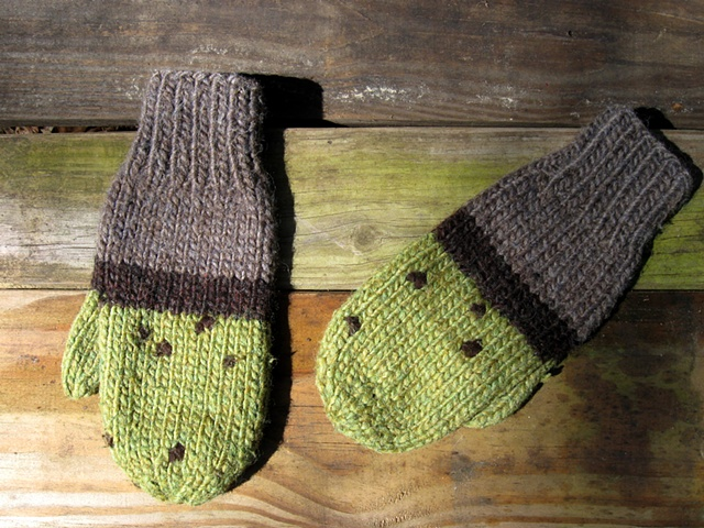 handknit mittens in green, grey, and dark brown inspired by the tidal lines of seaweed on rocks