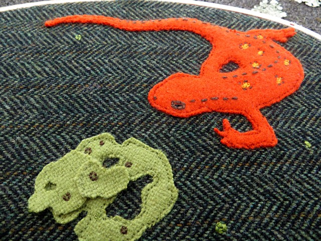 detail of forest floor fiber art piece with salamander and lichen by chelsea clarke
