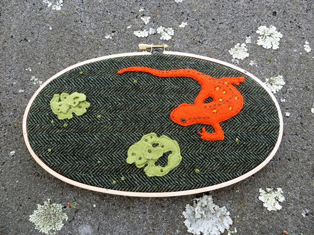 Red eft and lichen forest floor amphibian fiber wall art by Chelsea Clarke