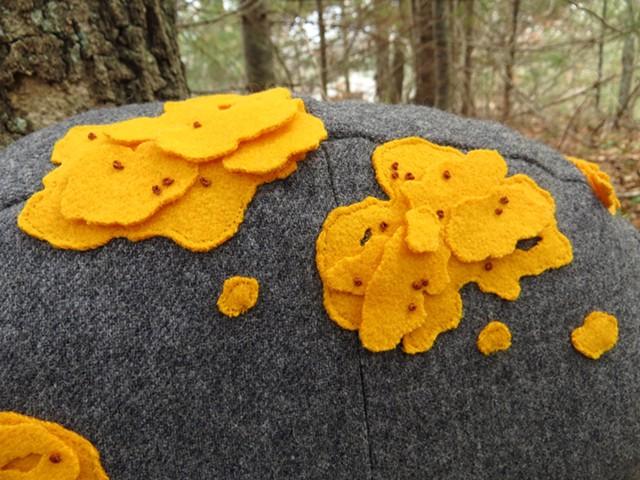detail of yellow wool lichen on stuffed rock shaped pillow, soft sculpture, by Chelsea Clarke